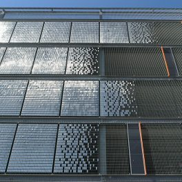 A kinetic facade made of stainless steel tiles used at Olympia Car Park as a striking visual wall cladding