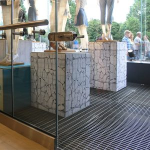 Stainless steel open mesh floor grating for shop window display