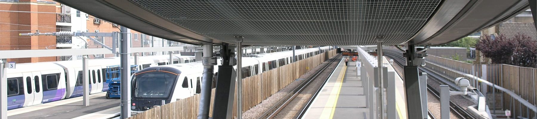 Stretto-22-bespoke-66x22-ceiling-panels-Abbey-Wood-Station-1-B